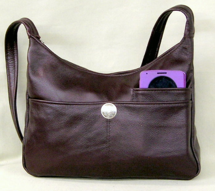 Burgundy Leather handbag with silver Concho Enter quantity when new window  opens. Medium  65.00. Large  73.00. Adjustable Strap Med  67.85 a38bb278d415d